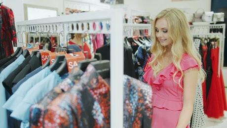 Pretty woman shops for clothes in mall store