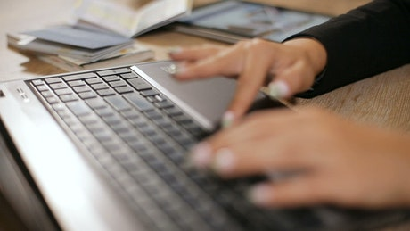 Professional hands type on laptop keyboard