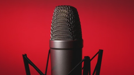 Professional microphone on a red background