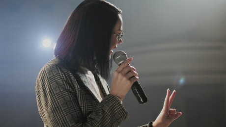 Professional speaker with a microphone in hand