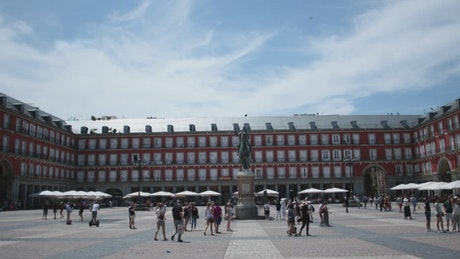 Public square with pedestrians, tourist public plaza