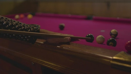 Punk person playing pool