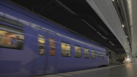 Purple subway train leaving