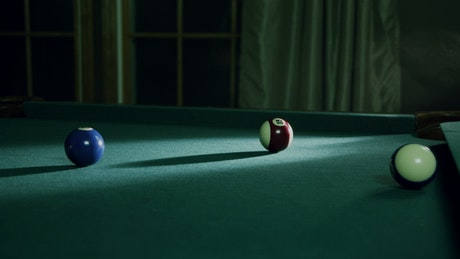 Putting a ball into a table pocket