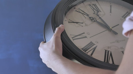 Putting on a wall clock