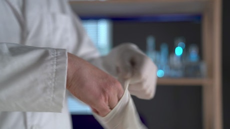 Putting on medical gloves