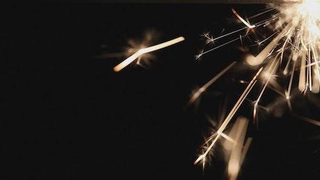 Pyrotechnic sparkler on a dark background