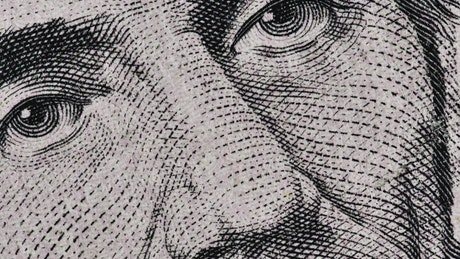 Quick sequence of detailed images of a 5 dollar bill