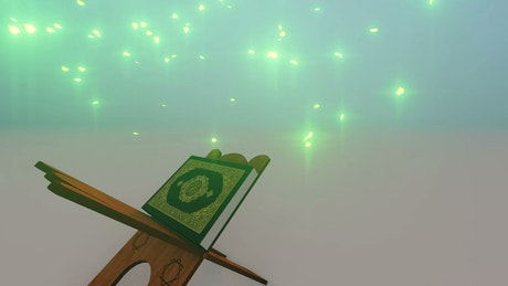 Quran book on a wooden lectern under magic rain