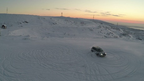 Racing around a snowy mountain