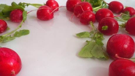 Radishes falling into water