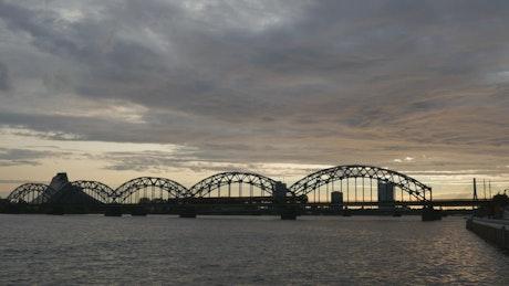 Railway bridge silhouette on a cloudy day