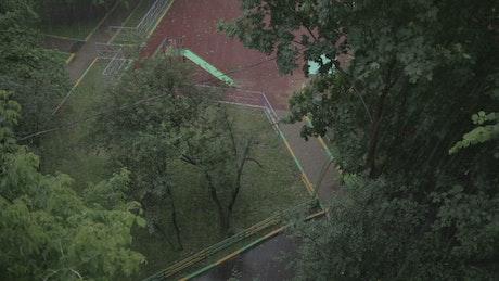 Rain falling in a city park