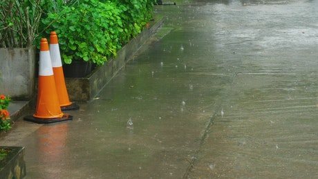 Rain falling in the sidewalk