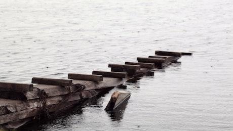 Rain falling on an old pier