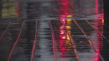 Rain falling on the sidewalk