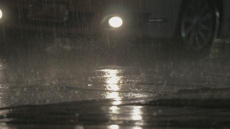 Rain falling over traffic