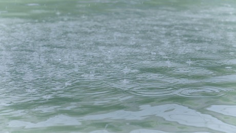 Rain in a fountain, slow motion shot