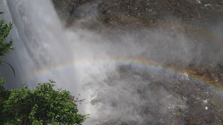 Rainbow at the bottom of the waterfall