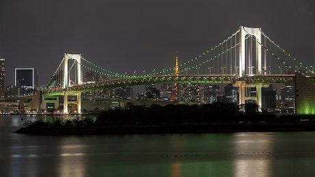 Rainbow bridge in Tokyo at night time lapse