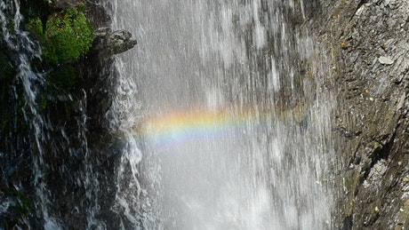 Rainbow forming in falling water