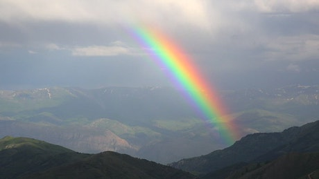 Rainbow glowing in the mountains