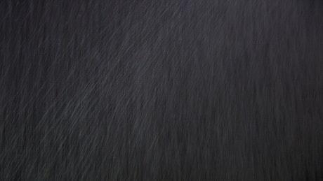 Rainfall against a screen