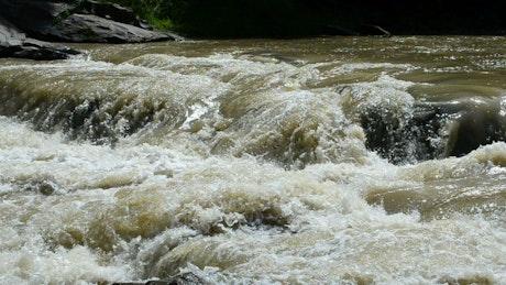Rainfall creating a river surge