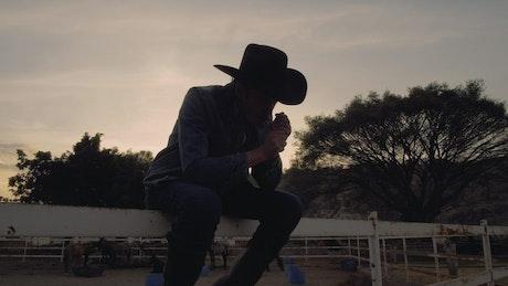 Rancher smoking at sunset