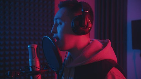 Rap singer records a song in a studio