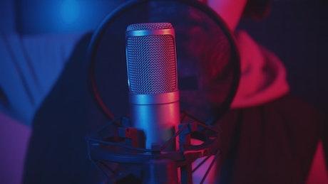 Rapper recording a track in a music studio