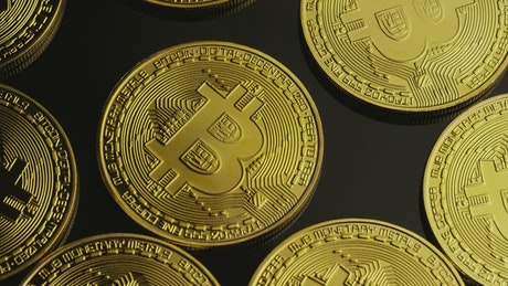 Real bitcoin coins on a black surface