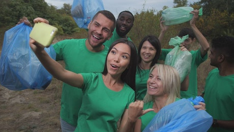 Recycling team taking a selfie outside