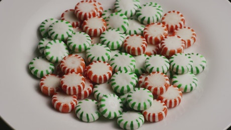 Red and green spermints on a plate rotating