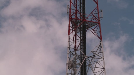 Red and white communications tower