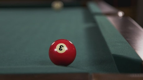 Red ball on a Pool Table