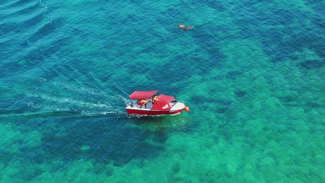 Red boat in crystal clear water