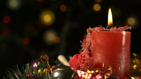 Red candle with Christmas decorations