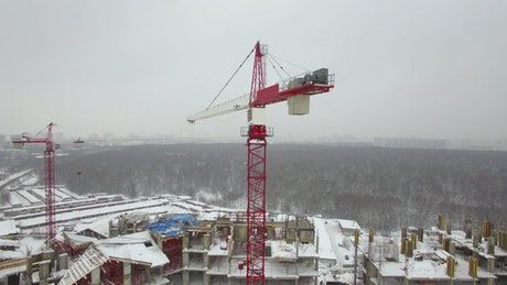 Red crane working in the snow