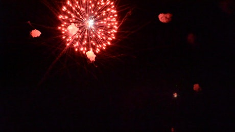 Red fireworks above the town