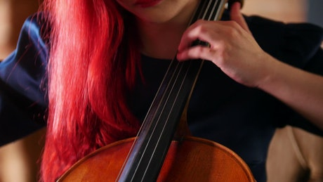 Red haired woman playing the Cello