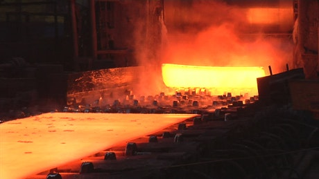 Red hot metal sheets going out of the furnace