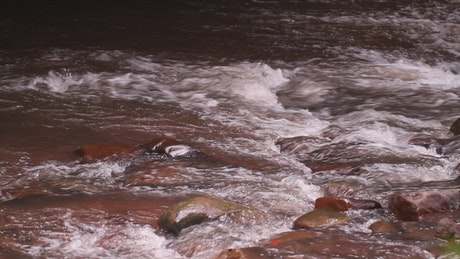 Red river flowing quickly