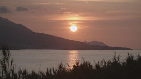 Red sunset sun on a coast