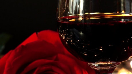 Red wine next to candles