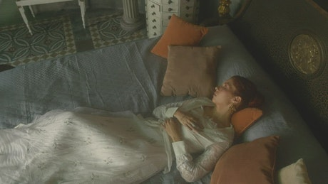 Redhead woman laying on the bed