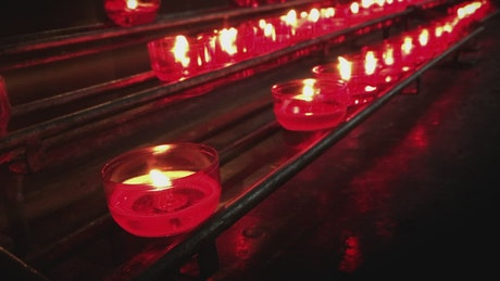 Religious or spiritual place with series of red candles