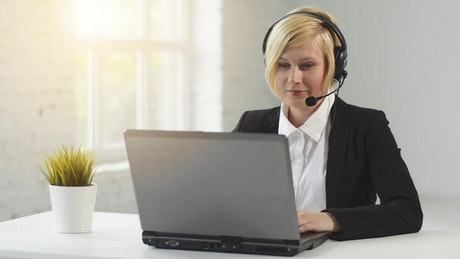 Remote worker greets customer hello on voice chat