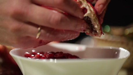 Removing the seeds from a Pomegranate