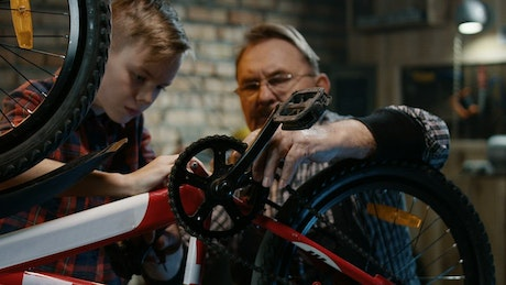 Repairing a bicycle in the garage